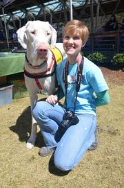 Brittany Dail poses with a Great Dane. Brittany works with the Great Dane Rescue Alliance, who was one of the exhibitors during the festival.