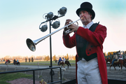 David Mitchell's bugle signals the start of each race. Meadows this year hosted 44 live race days, down from 58 in 2012.