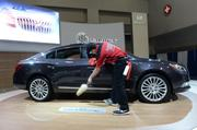 The staff members at the 2014 Washington Auto Show are in constant cleaning mode.