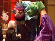 Zell Schulman of Arts Wave talks with some Madcap Puppets who attended the event.