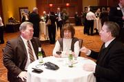 From left are Dave Armstrong (president of Thomas More College) his wife Leslie and Joe Filippi.