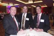 From left are Rob Lambert of USI, Jeff Bunger of Loth and Paul Darwish of Graydon Head.