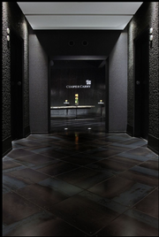 The office is designed to create a memorable first impression.  Visitors emerge from the elevator into a dark lobby with the Cooper Carry logo highlighted as a focal point. The lighting, hidden above the ceiling, highlights the metallic flecks in the granite walls and shows off the rich patina of the steel floor.