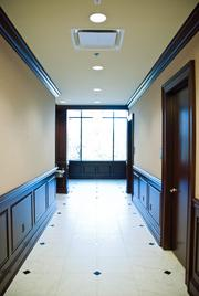 The first-floor hallway leading to the elevator.