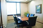 One of three conference rooms, this one is divided from another by a retractable wall.
