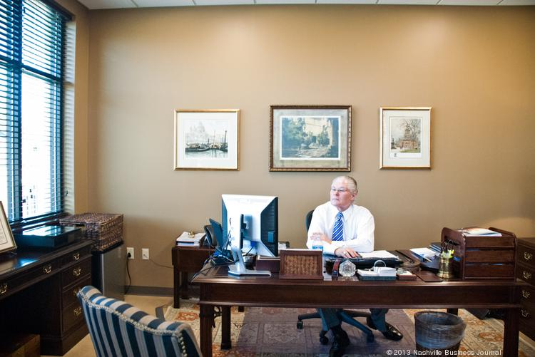 J Dell Crosslin, managing principal at Crosslin & Associates PC, works in his new executive office space.