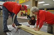 Capitals Hall-of-Famer Rod Langway works along side volunteers during the Monumental Sports & Entertainment Foundation MLK Day of Service project at Playworks.