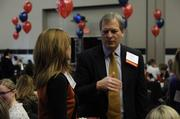 Dan Rexroth of John Knox Village talks with an attendee before the 2014 Healthiest Employers luncheon. The company was an honoree in the 250-999 employees category.