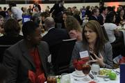 Heather Humphrey of Kansas City Power & Light talks with Emeka Anyanwu of GPE during the 2014 Healthiest Employers luncheon.