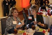 Carolyn Merker and Jennifer Jennings of Harrah's North Kansas City Casino & Hotel prepare for lunch at the 2014 Healthiest Employers event.
