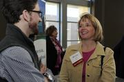 WaterOne's Becky Bryan and Kevin Smith talk before the 2014 Healthiest Employers event. The company won 1st place in the 250-999 employees category.