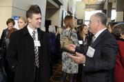 Connor Clune of Lockton speaks with Jim Vigiliaturo, an employee of CBIZ Benefits and Insurance Services. CBIZ was a sponsor of the 2014 Healthiest Employers event.