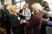 Michelle Kelly of Kansas City Southern and Jane Dahem of Hays Co. talk during the 2014 Healthiest Employers event.