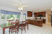 14927 Joseph Meadows: The kitchen features cherry cabinets.