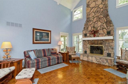 14927 Joseph Meadows: The two-story great room is adjacent to the kitchen.