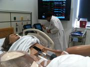 Dr. Debra Ford programs a high-tech human patient simulator designed to demonstrate a pregnant woman giving birth. Ford spearheaded a new $5 million Health Sciences Simulation Center at Howard University this week..