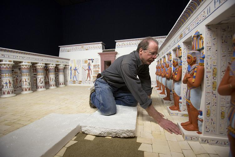 "Sculptor and artist Craig Yanek reassembles a model from the former ""Temples, Tells and Tombs"" exhibit that was removed more than five years ago to make room for traveling exhibitions."