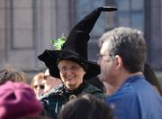 A properly dressed fan. Or maybe she's really a witch. Whatever, it's a nice hat.