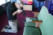 Paulus takes a close up of one of the toys.