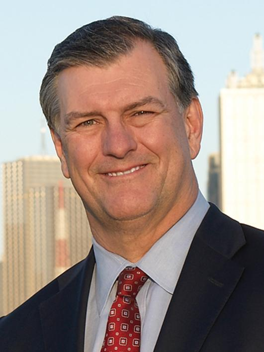 Mayor Mike Rawlings warned the Dallas City Council that a lawsuit could occur if they denied drilling permits for Trinity East Energy.