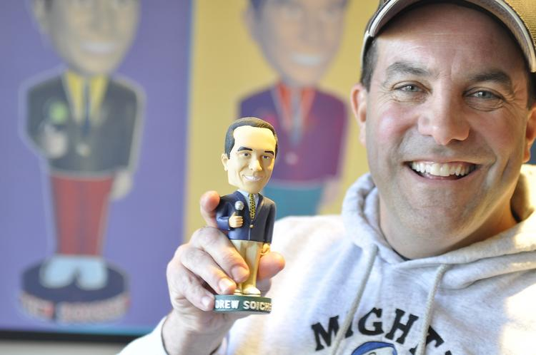 Drew Soicher talks with Bill Husted at his home in Aurora. Soicher has a bobblehead collection that numbers at least 2,000, including one of himself.