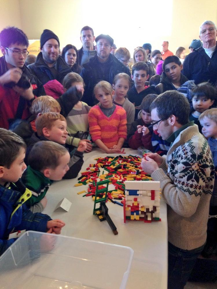 Ian Coffey draws a crowd as he competes for a full-time job at the new LegoLand center opening in Somerville.