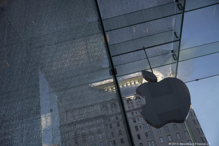 A pane of glass stands shattered on the exterior of an Apple Inc. store in New York.