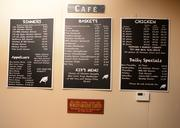 A menu board in The Coop Restaurant. The menu appearance will likely be updated with the marketing makeover.
