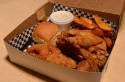 A chicken dinner to-go order. The restaurant specializes in fried chicken, barbecue ribs, burgers and coneys.