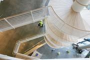 The inside of the University of Baltimore's law building maintains its modern look with concrete floors, bamboo walls and an open spiral staircase.