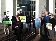 Protesters gathered outside Duke Energy Center in uptown Charlotte on Monday, Jan. 27, 2013.