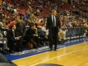 Sixers Coach Brett Brown paces along the same sign during the game.
