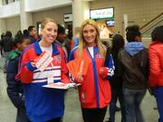 Rebecca Freed (left) and Kim Hillen hand out online poker promotional material.