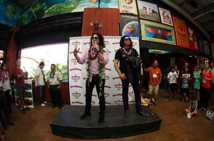Paul Stanley, left, and Gene Simmons of KISS attend a private blessing of a new Rock & Brews restaurant in Hawaii.