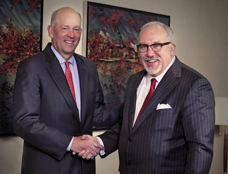VantageSouth Bankshares Inc. CEO Scott Custer, left, will become the CEO of Yadkin Financial Corp. following its acquisition of VantageSouth. Joe Towell, right, will become the executive chairman of the merged company. Towell is currently CEO of Yadkin Financial.