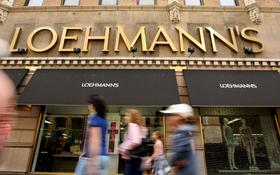 Pedestrians walk past Loehmann's department store in the Chelsea neighborhood of New York. All of its stores are now closing down as part of a bankruptcy liquidation.