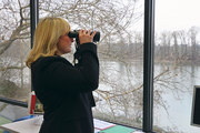 Jennifer Fox, executive director of OTRADI, watches for otters and other river life from her office in Southwest Portland.