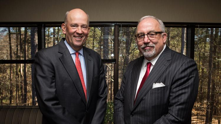 CEO Scott Custer (left) poses with Joe Towell, former CEO of Yadkin who is now chairman of the combined VantageSouth-Yadkin Financial.