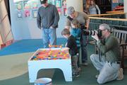 Activities went on as usual at the museum while the Milwaukee Business Journal shot its photos.