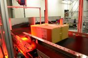 Cartons are scanned, then routed for shipping.