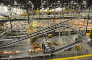 A maze of rollers and conveyor belts.