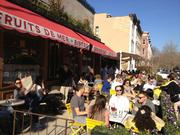 Diners enjoying the patio on Le Diplomate's first day open.