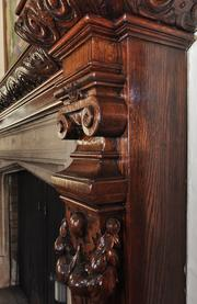 The cherry wood fireplace in the mansion's main living room.