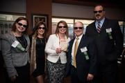 From left, Kelly Simile of Allegheny Valley Bank, Maria Brady of Marakae Marketing, and Marsha Posset, Andrew Hasley and Daniel Koller of Allegheny Valley Bank take a moment to pose during the Pittsburgh Business Times Book of Lists party at the Rivers Club in downtown Pittsburgh.