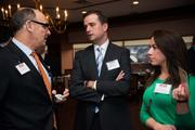 Joel Rosenthal, left, and Chuck Oshurak of Schneider Downs talk with Nicole Burke of the Allegheny Conference on Community Development.