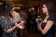 Mary McCarly, left, and Amanda McAlpine, both of AE Works, talk during the Pittsburgh Business Times Book of Lists party.