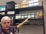Andrew Schuerger shows off the various replicas of Mars soil.
