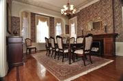 The dining room in UAlbany's presidential mansion. The residence is on the market for $625,000. Annual taxes are estimated at $20,000.