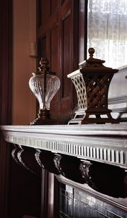 A mantel in the University at Albany's president's mansion. The University at Albany Foundation bought the mansion in 1998 for $650,000. It's on the market for $625,000.