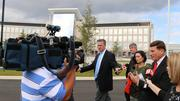 Mica and the press entourage in front of the unfinished hospital and clinic at the Orlando VA Medical Center.